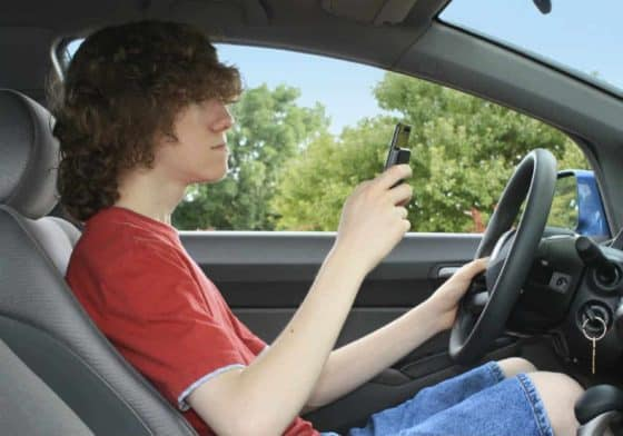 young driver on cell phone