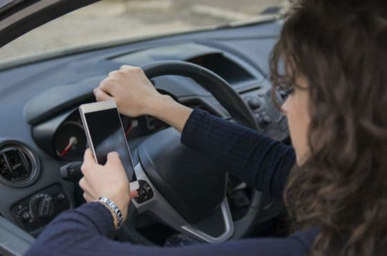 woman distracted by cell phone while driving