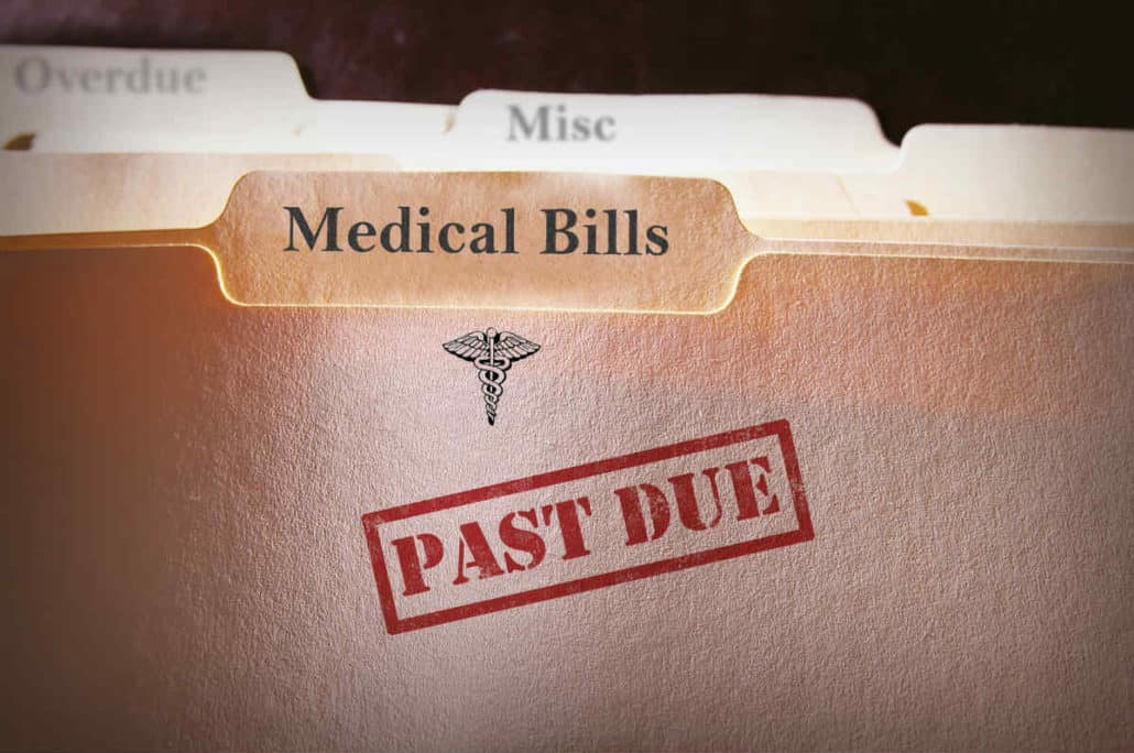 folder containing medical bills past due
